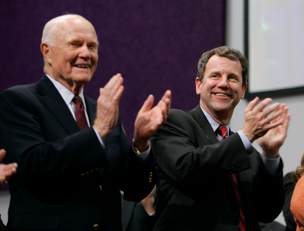 . Former Sen. John Glenn, left, claps alongside Democratic Senate candidate Sherrod Brown, to a song by the Living Faith Mass Choir, during a campaign stop at the Living Faith Apostolic Church in Columbus, Ohio, Sunday, Nov. 5, 2006.  Brown is running against Republican incumbent Sen. Mike DeWine.(AP Photo/Nati Harnik)