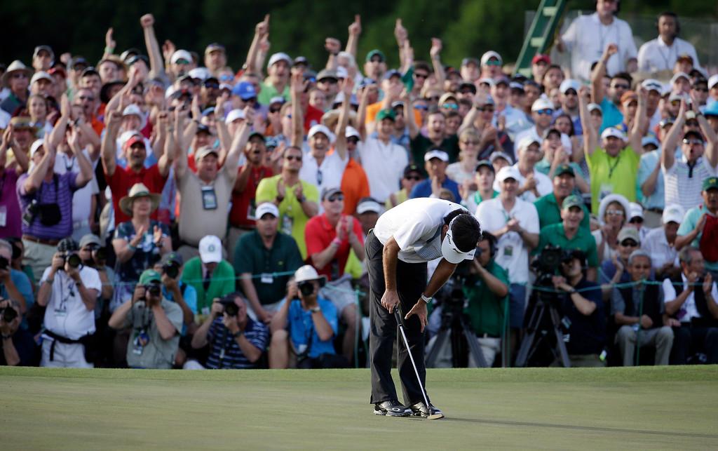 . Bubba Watson reacts after winning the Masters golf tournament Sunday, April 13, 2014, in Augusta, Ga. (AP Photo/Darron Cummings)