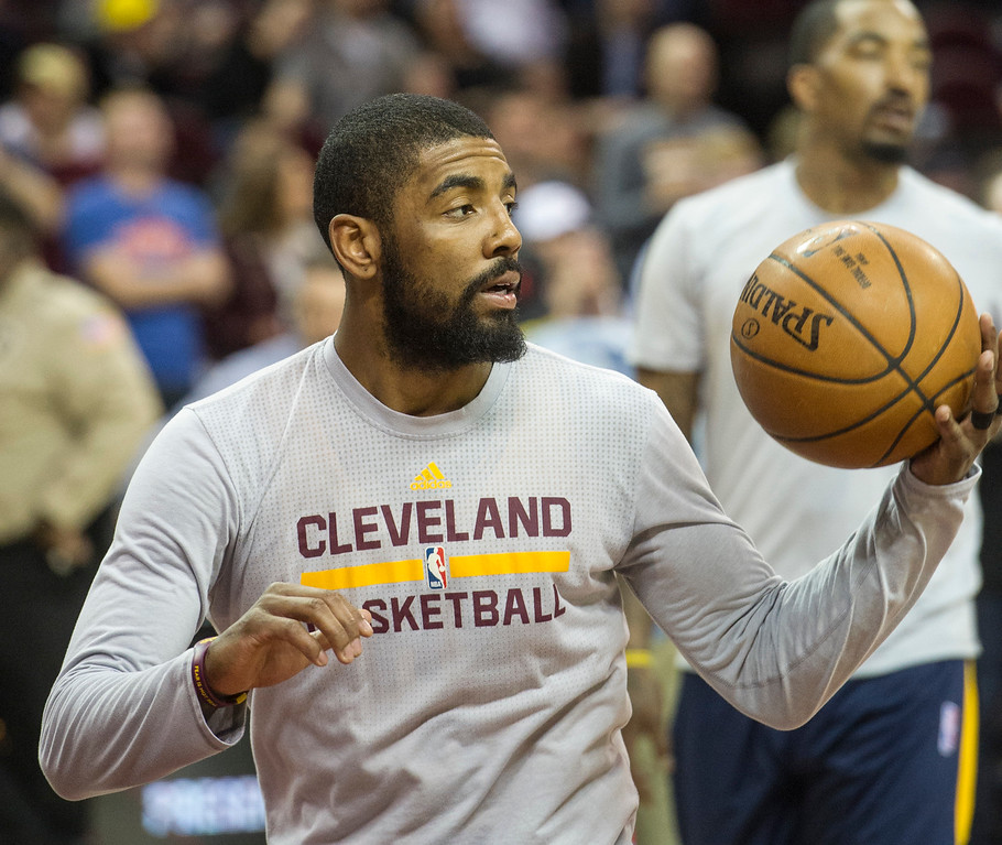 . Cleveland Cavaliers\' Kyrie Irving (2)warms up prior to an NBA basketball game against the Washington Wizards in Cleveland, Saturday, March 25, 2017. (AP Photo/Phil Long)