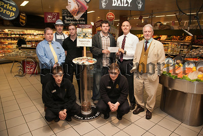 Barry Traynor receives a cheque from Supervalu Manager Kieran Lowry. Also pictured is Rowan Hand from the Newry africa Link and staff at Supervalu Conor O'Neill, David Finnegan, Sean McGivern, Kevin Dunne and Martin Boyle. R1339004