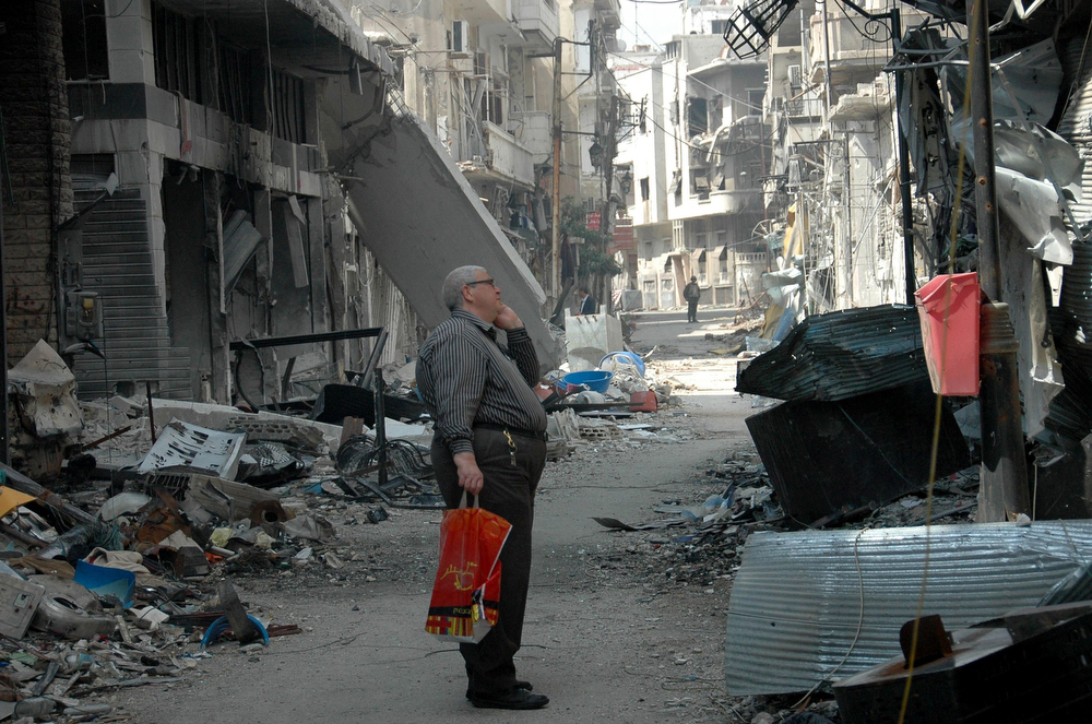 . A Syrian resident of Homs looks at a damaged building after returning to the Christian Hamidiyeh neighbourhood of the old town of Syria\'s central city on May 9, 2014 after the last Syrian rebels left Homs\' Old City under an evacuation deal that hands the government a symbolic victory. As troops moved in to clear out explosives, hundreds of civilians began returning to see what remained of their homes in the Old Town, which has been under nearly daily bombardment during a two-year siege. (AFP/Getty Images)