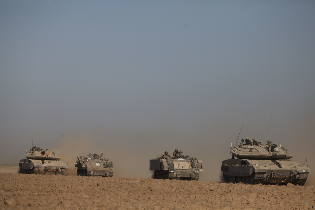 . Israeli tanks and Army Armoured Personnel Carrier (APC) seen moving along the border with Gaza on July 17, 2014 on Israel\'s border with the Gaza Strip. As the Israeli operation \'Protective Edge\' enters it\'s tenth day, the body count in Gaza has reach over 200 people. One Israeli has been killed in a Mortar attack.  (Photo by Lior Mizrahi/Getty Images)