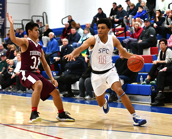 2/4/2020 Mike Orazzi | StaffrSt. Paul's Noah Waters (11) and Torrington's Brian Ballesteros (31) during Tuesday night's boys basketball game with Torrington in Bristol.