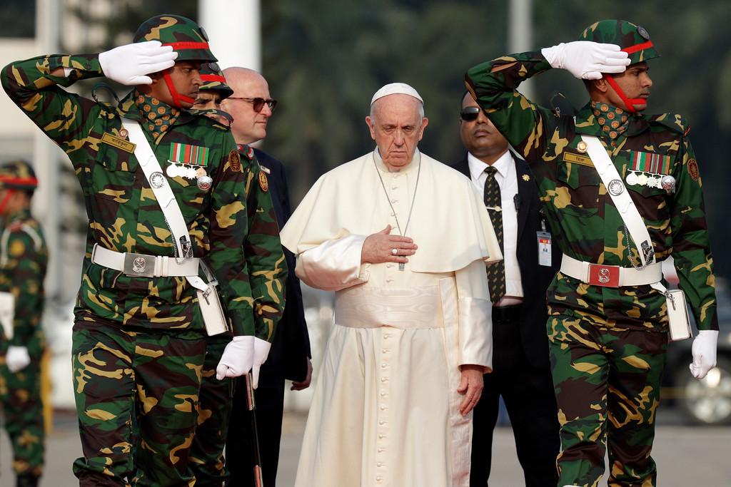. Pope Francis reviews a honor guard as he arrives at Dhaka\'s international airport, Bangladesh, Thursday, Nov. 30, 2017. (AP Photo/Andrew Medichini)