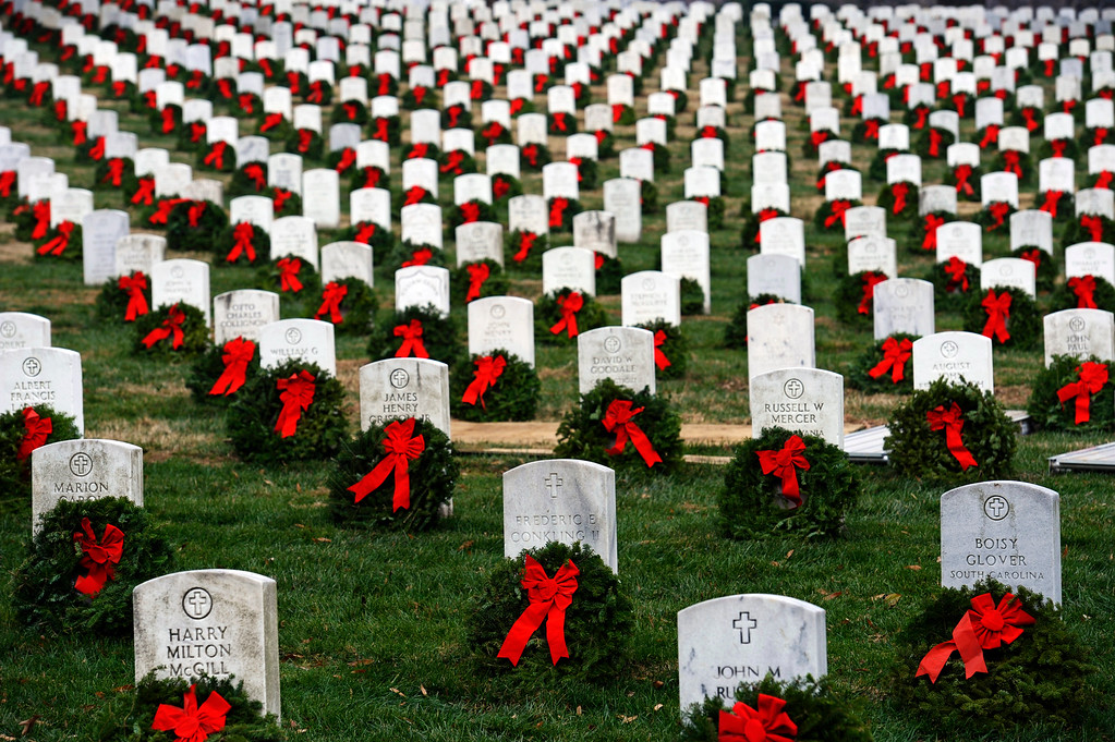 . FILE - In this Dec. 11, 2010 photo, volunteers placed close to 24,000 wreaths on headstones at Arlington National Cemetery in Arlington, Va.  The wreaths were donated by Morill Worcester, owner of the Worcester Wreath Company of Harrington, Maine.  Wreaths Across America expects to ship 470,000 to 500,000 wreaths this month to veterans� graves in more than 900 locations. Starting Sunday, Dec. 8, 2013, 11 trucks will begin rolling toward Arlington.  Next year, the Maine-based organization wants to place a wreath on every headstone, about 230,000 of them, at Arlington National Cemetery.  (AP Photo/Cliff Owen, file)