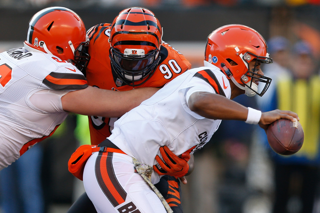 . Cleveland Browns quarterback DeShone Kizer, right, is pressured by Cincinnati Bengals defensive end Michael Johnson (90) in the first half of an NFL football game, Sunday, Nov. 26, 2017, in Cincinnati. (AP Photo/Gary Landers)