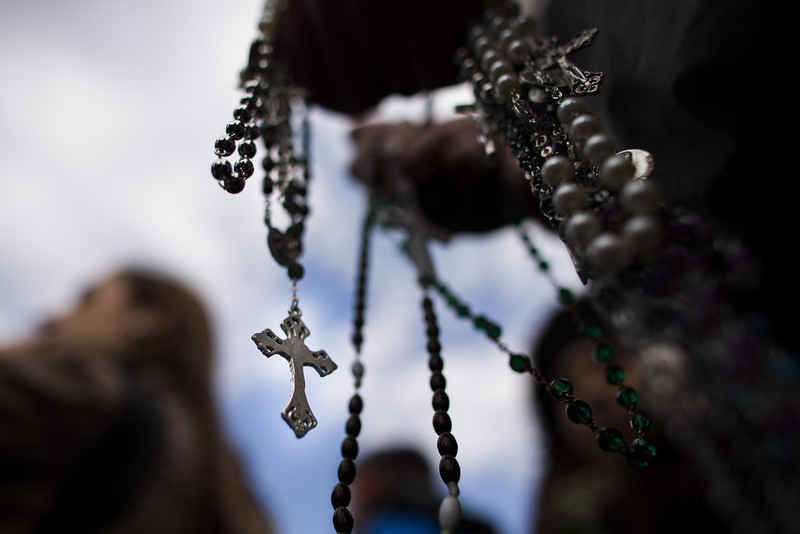 . A visitor holds a rosary chain on February 24, 2013 in Vatican City, Vatican. Pope Benedict XVI delivers his last Angelus Blessing from the window of his private apartment to thousands of pilgrims gathered in Saint Peter\'s Square on February 24, 2013 in Vatican City, Vatican. The Pontiff will hold his last weekly public audience on February 27, 2013 before he retires the following day. Pope Benedict XVI has been the leader of the Catholic Church for eight years and is the first Pope to retire since 1415. He cites ailing health as his reason for retirement and will spend the rest of his life in solitude away from public engagements.  (Photo by Carsten Koall/Getty Images)