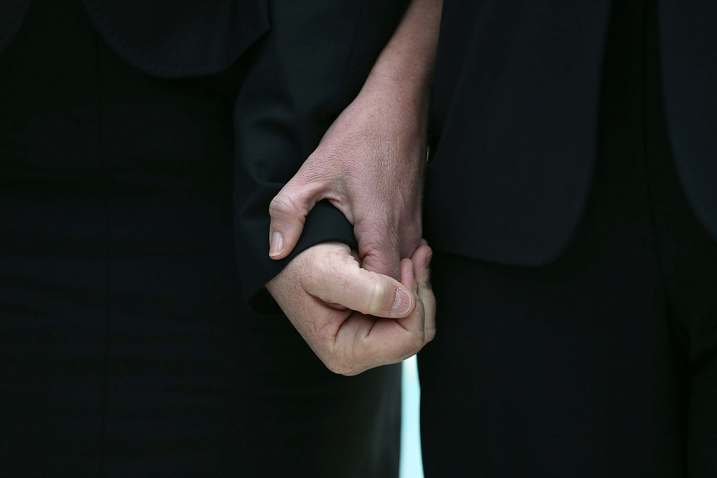 . Plaintiff couple Sandy Steier (L) and Kris Perry hold hands after attending oral arguments at the U.S. Supreme Court after oral arguments, on March 26, 2013 in Washington, DC.  (Photo by Mark Wilson/Getty Images)