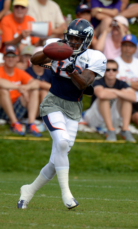 . Denver Broncos WR Lamaar Thomas (19) catches a pass during training camp August 1, 2013 at Dove Valley. (Photo By John Leyba/The Denver Post)