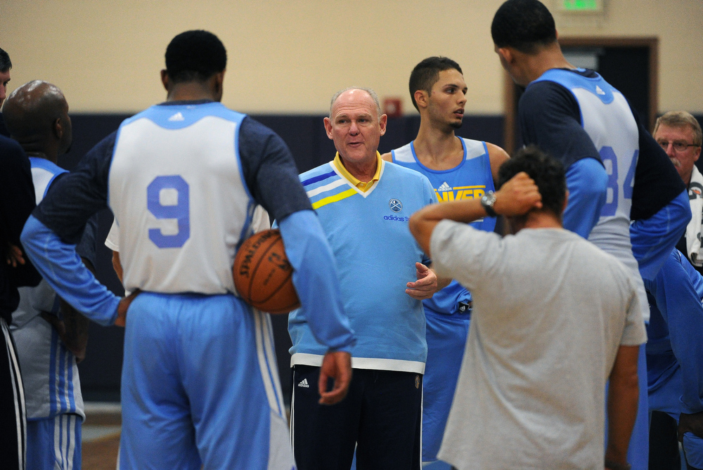 """. Denver Nuggets head coach George Karl talks with players after practice today October 4th, 2012. The Denver Nuggets assistant coach John Welch, is becoming known for his crazy hard workouts with the team.  GM Masai Ujiri has been gushing about him this off season. Welch, who worked for seven seasons at Fresno State under Jerry Tarkanian (his coach at UNLV in the 1980s), is known as the best \""""work-out\"""" assistant coach in the league yet fans don\'t know him. In his fourth season with the Nuggets, he\'s a wicked-smart assistant, key to the Nuggets\' success.  He is photographed during the team\'s practice session today October 4th, 2012.  Helen H. Richardson, The Denver Post"""