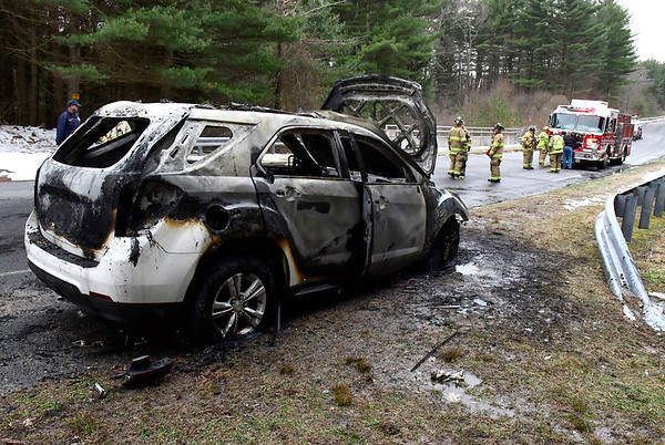 3/25/2020 Mike Orazzi | Staff The scene of a car fire on Preston Road in Plymouth near the intersection with Route 72 on Wednesday afternoon. Both occupants were able to get out on their own, the vehicle was destroyed.