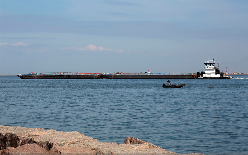 A double barge is pushed up the Ship Channel.