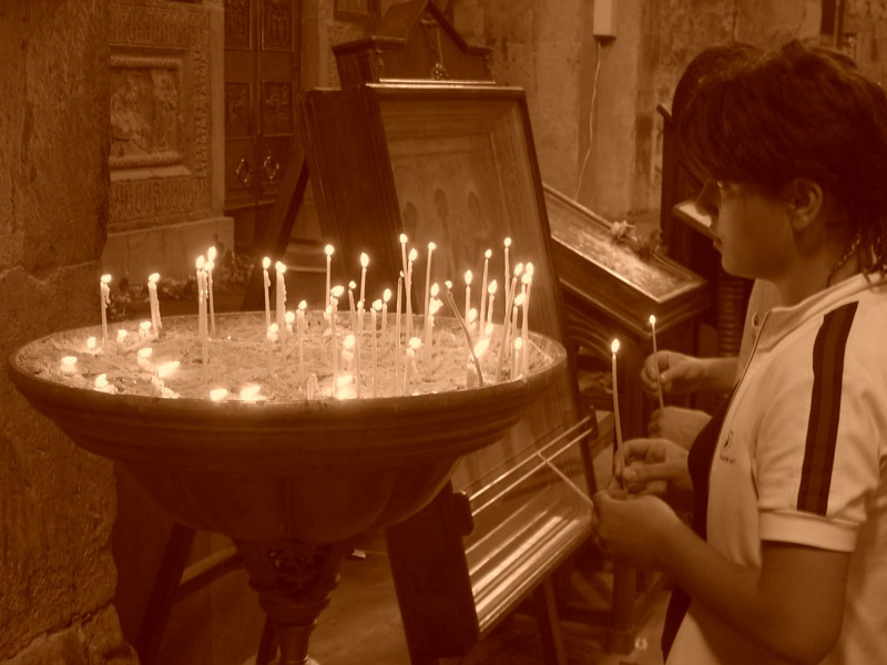 Girl Lighting Candles at Svetitskhoveli Cathedral - Mtskheta, Georgia