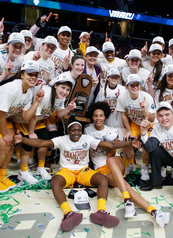 . Central Michigan womens basketball team celebrates after defeating Buffalo 96-91 in an NCAA college basketball game during the championship of the Mid-American Conference tournament Saturday, March 10, 2018, in Cleveland. (AP Photo/Ron Schwane)