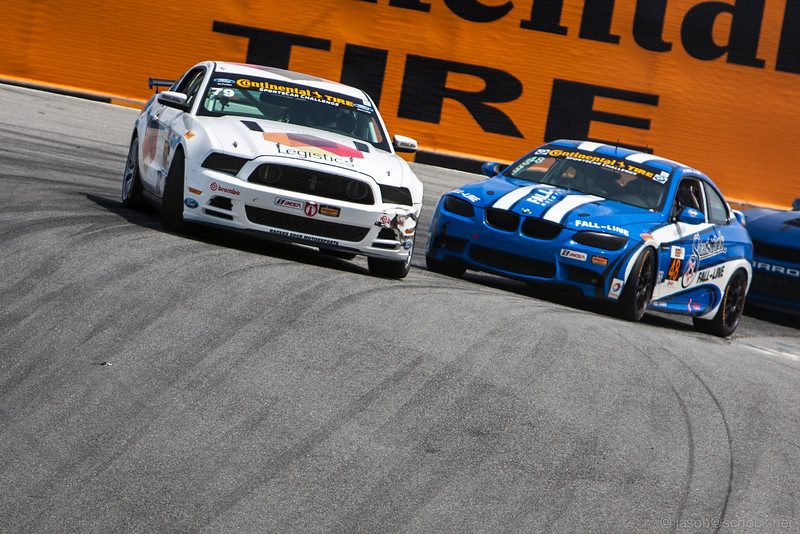 The #79 Racers Edge Motorsports Mustang slides through The Corkscrew.