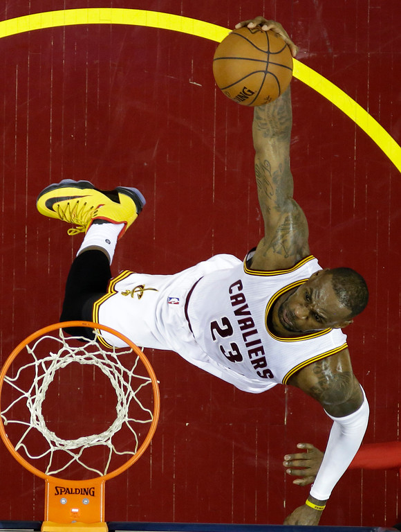 . Cleveland Cavaliers\' LeBron James dunks against the Toronto Raptors during the first half of Game 1 of the NBA basketball Eastern Conference finals, Tuesday, May 17, 2016, in Cleveland. (AP Photo/Tony Dejak)