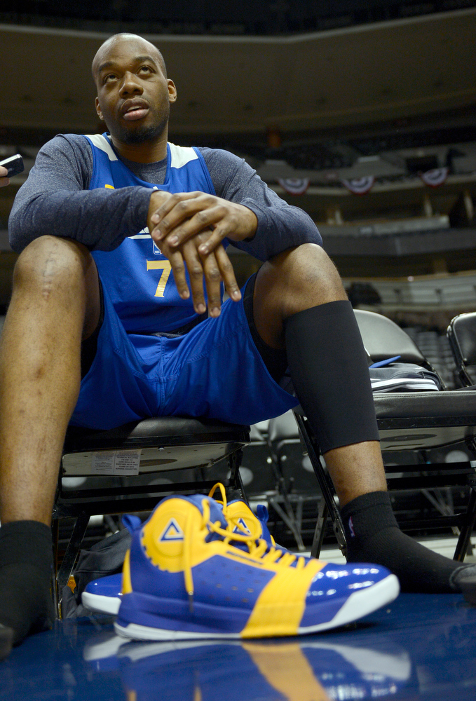 . Carl Landry (7) of the Golden State Warriors puts on his shoes before practice April 22, 2013 at Pepsi Center. The Golden State Warriors prepare for game two of the first round of the NBA playoffs against the Denver Nuggets. (Photo By John Leyba/The Denver Post)