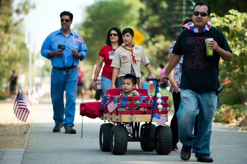 . Local residents participate in the freedom walk, a 4th of July community procession along the Greenway Trail, in Whittier on Thursday, July 4, 2013. (SGVN/Staff photo by Watchara Phomicinda)