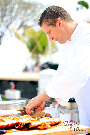 Chef Marc McDowell of Makena Beach & Golf Resort prepares his porchetta (sourced from Malama Farm) for the Grand Tasting competition. © 2012 Sugar + Shake