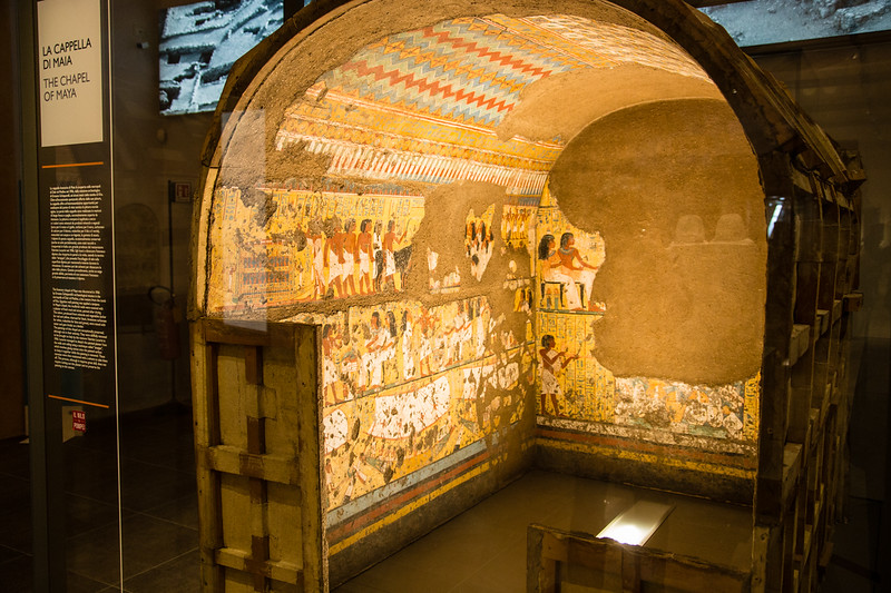 vaulted space with egyptian images on the wall