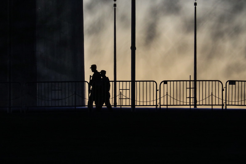 National Gaurd troops patrol the Washington Monument at sunset