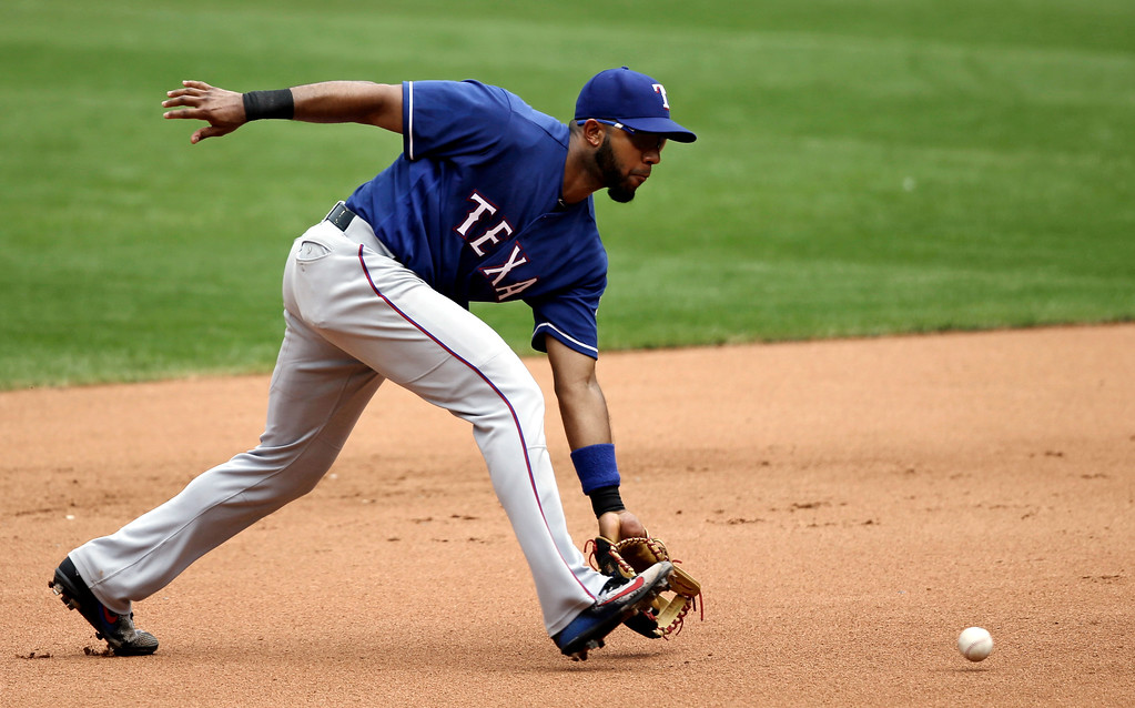 . Texas Rangers\' Elvis Andrus fields a ball hit by Cleveland Indians\' Brandon Guyer in the fourth inning of a baseball game, Thursday, June 29, 2017, in Cleveland. (AP Photo/Tony Dejak)