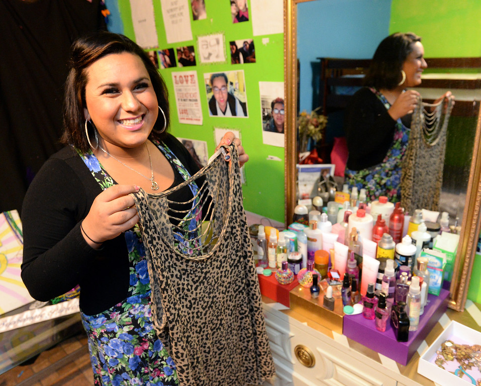 . Transgender student, Staceyy Holidayy, 15, who received a two-day suspension on Wednesday for a dress code violation at El Rancho High School in Pico Rivera, Calif., shows the top she was wearing when she was suspended on Friday January 10, 2014. Holidayy, formerly Roberto Valencia, was told that she was not allowed to use the girl\'s restroom but had to use the restroom in the nurses office. (Staff Photo by Keith Durflinger/Whittier Daily News)
