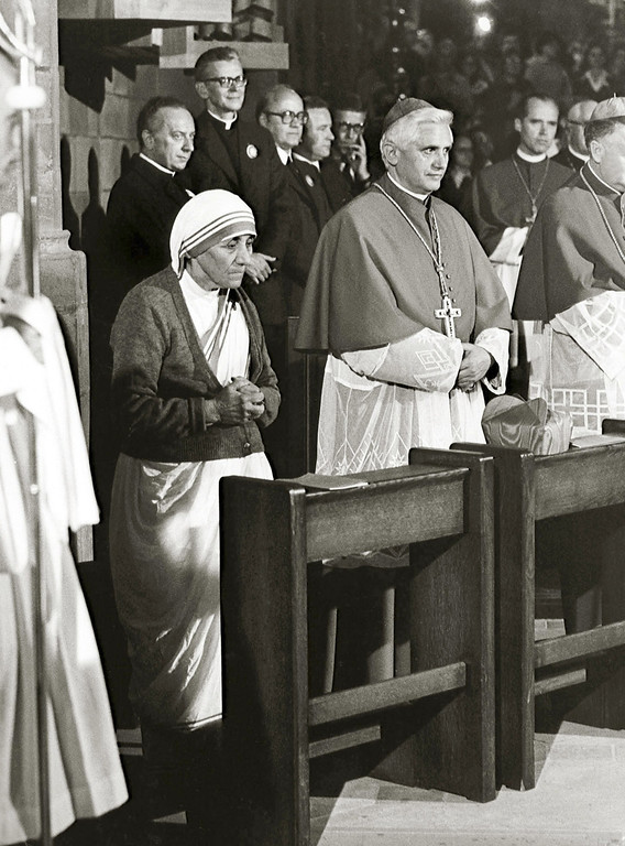 . A photo taken during the 85th German Catholics Days in Freiburg between 13 and 17 September 1978 shows the Cardinal Joseph Ratzinger (C) praying next to Mother Teresa. Ratzinger was elected the 265th pope of the Roman Catholic Church 19 April 2005 at the Vatican City, becoming Pope Benedict XVI. KNA-BILD/AFP/Getty Images