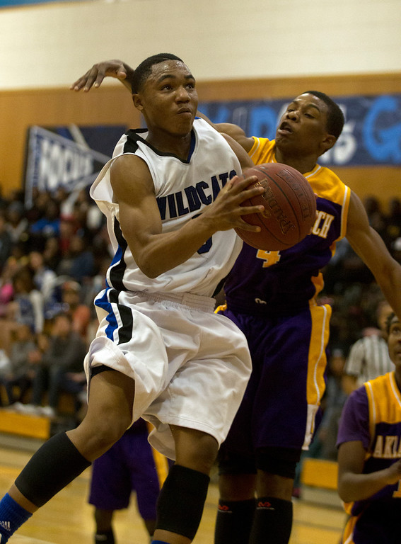 . Oakland High School\'s Ocie Williams (5) drives past Oakland Tech defender Pooh Woodfolk during the third quarter of their Oakland Athletic League semi-final tournament game, Tuesday, Feb. 26, 2013 in Oakland, Calif. Oakland won, 70-58. (D. Ross Cameron/Staff)