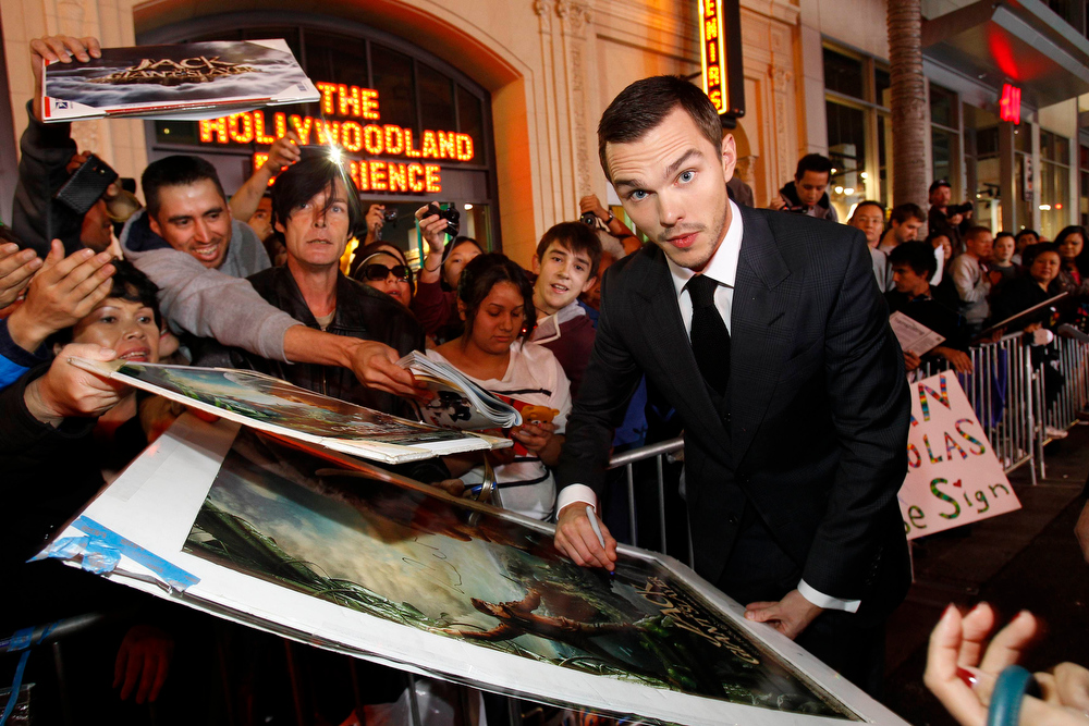 ". Cast member Nicholas Hoult signs autographs at the premiere of ""Jack the Giant Slayer\"" in Hollywood, California February 26, 2013. The movie opens in the U.S. on March 1.  REUTERS/Mario Anzuoni"
