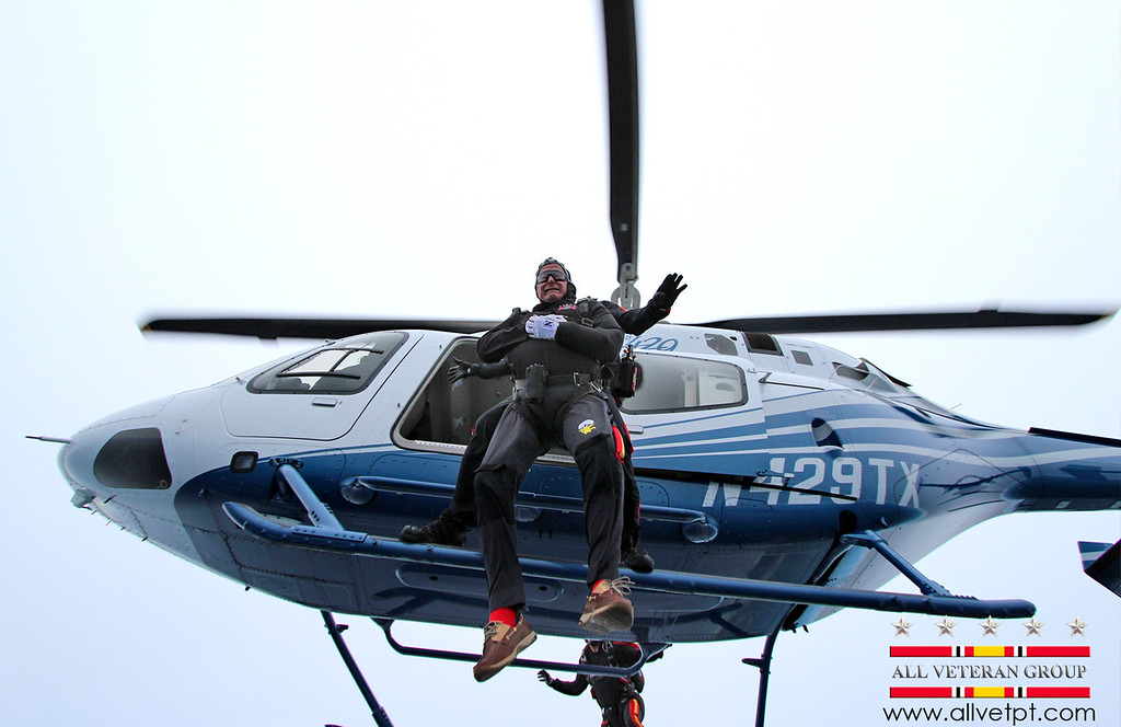. In this photo provided by the All Veteran Parachute Team, former President George H.W. Bush is tethered to Mike Elliott, a member of the All Veteran Parachute Team, on a jump from a helicopter as they celebrate Bush\'s 90th birthday in Kennebunkport, Maine, Thursday, June 12, 2014. (AP Photo/All Veteran Parachute Team, Charles Cooley)