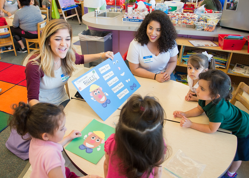 Kristie McClane (left) and Emerald Perez go over classroom rules with students at the Blanche Davis Moore Early Childhood Development Center.
