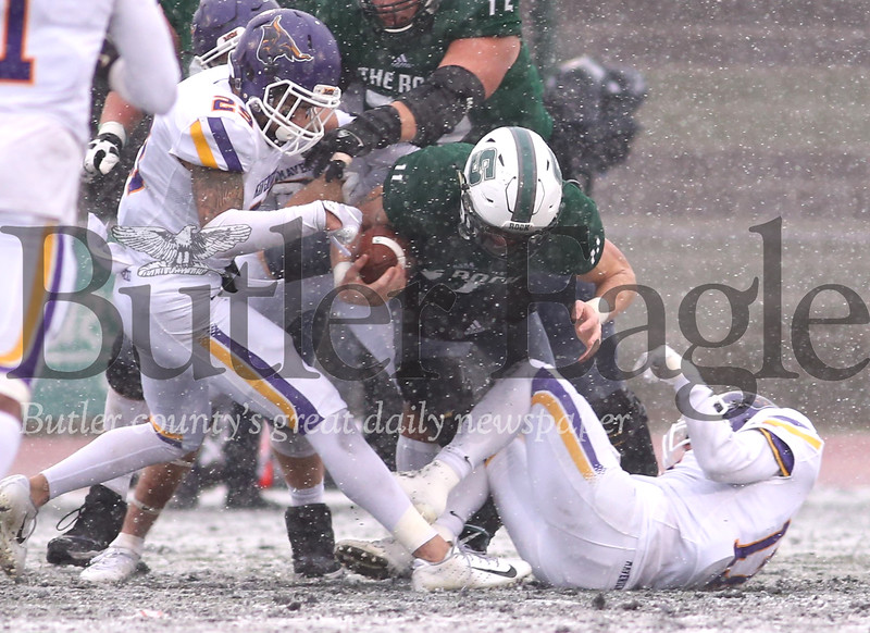 Slippery Rock wide reciever Henry Litwin attempts to push through tackle attempts following a reception in Saturday's 58-8 playoff loss to Minnesota State. Seb Foltz/Butler Eagle