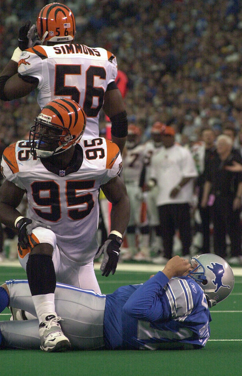 . Detroit Lions quarterback Charlie Batch (10) lays on the ground after getting hit by Cincinnati playerSteve Foley (95) during Sunday\'s game played at the Pontiac Silverdome. The Lions lost 31-27 to the Bengals.