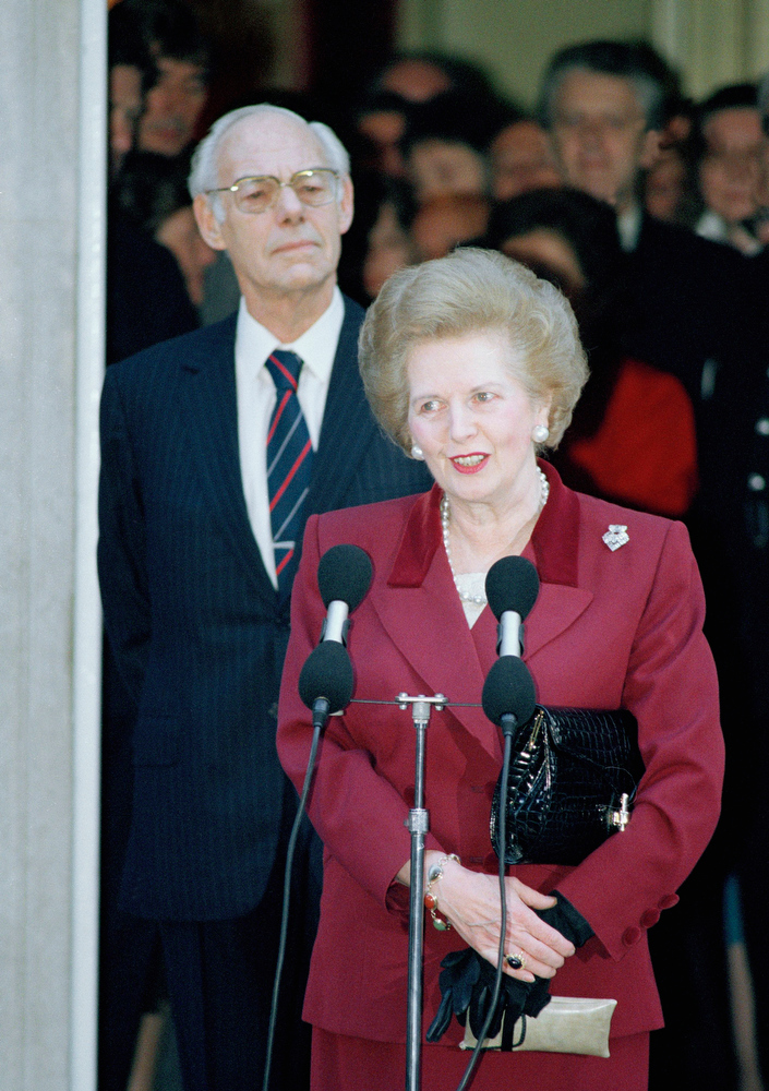 . Margaret Thatcher makes a statement to reporters as Denis Thatcher listens, as she leaves No. 10 Downing Street, Westminster in a Wednesday, Nov. 28, 1990 file photo, for Buckingham Palace where she will resign as Prime Minister to Queen Elizabeth II. Thatchers former spokesman, Tim Bell, said that the former British Prime Minister Margaret Thatcher had died Monday morning, April 8, 2013, of a stroke.  She was 87. (AP Photo/Martin Cleaver, File)