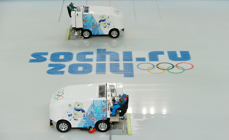 . Ice resurfacing machines make final preparations before the start of the men\'s team short program figure skating competition, the first event to be held at the Iceberg Skating Palace during the 2014 Winter Olympics, Thursday, Feb. 6, 2014, in Sochi, Russia. (AP Photo/Vadim Ghirda)