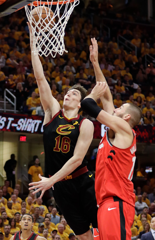 . Cleveland Cavaliers\' Cedi Osman (16), from Turkey, shoots against Toronto Raptors\' Jonas Valanciunas, from Lithuania, in the first half of Game 4 of an NBA basketball second-round playoff series, Monday, May 7, 2018, in Cleveland. (AP Photo/Tony Dejak)
