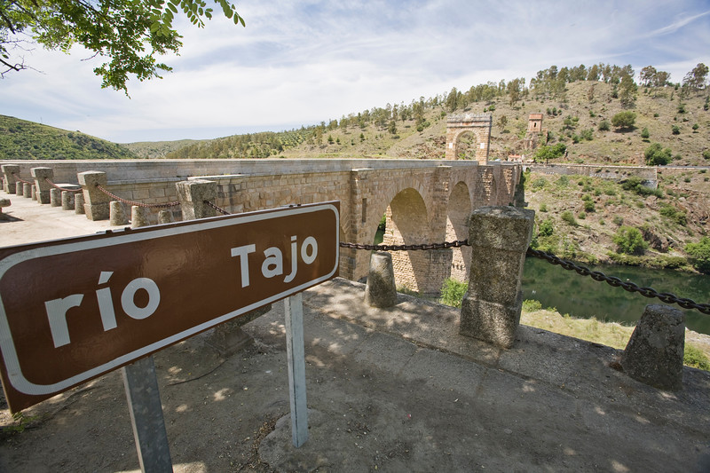 Road sign of Tagus river at Alcantara Roman bridge, Caceres, Spain
