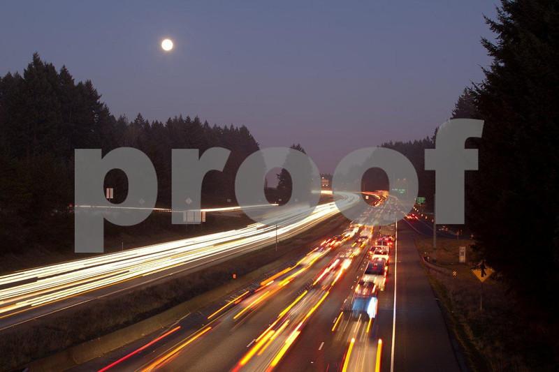 Heavy traffic under a full moon on I-5 in Washington State.