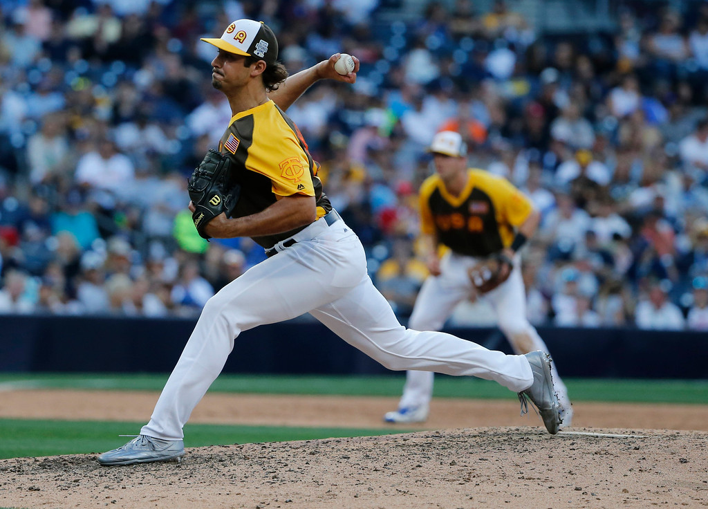. U.S. Team\'s J.T. Chargois, of the Minnesota Twins, throws against the World Team during the eighth inning of the All-Star Futures baseball game, Sunday, July 10, 2016, in San Diego. (AP Photo/Lenny Ignelzi)
