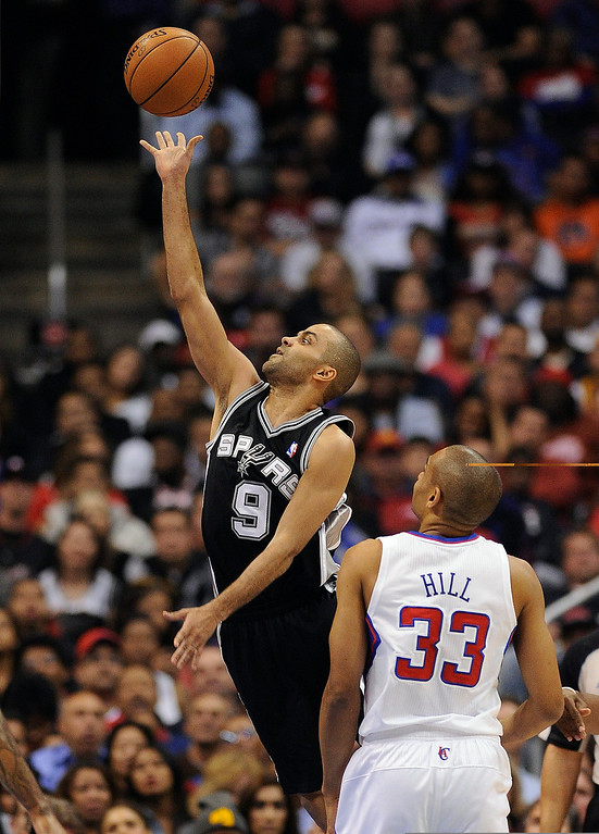. The Spurs\' Tony Parker #9 lays the ball up as the Clippers\' Grant Hill #33 looks on during their game at the Staples Center in Los Angeles Friday, February  21, 2013. (Hans Gutknecht/Staff Photographer)