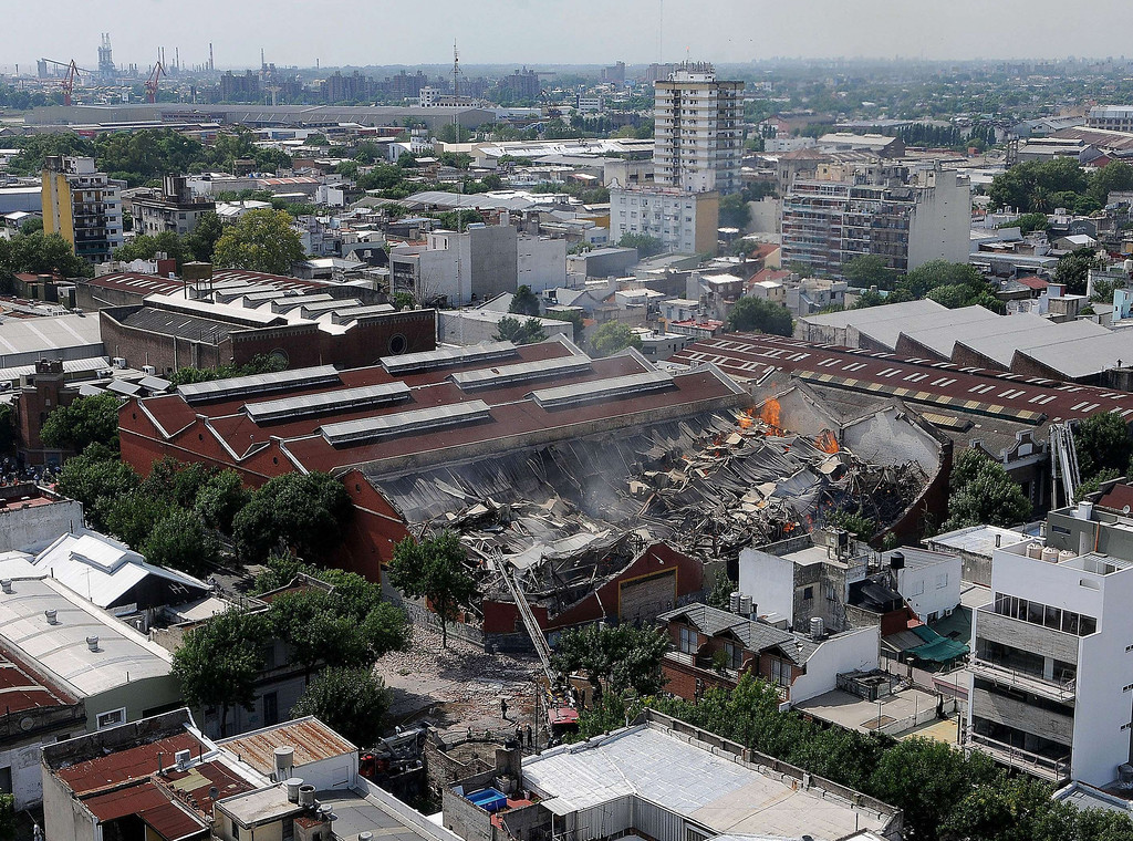 . Picture released by Diario Popular via Noticias Argentinas showing a fire at a warehouse in Barracas, in southern Buenos Aires, on February 5, 2014.   AFP PHOTO / NA / DIARIO POPULAR / GUSTAVO FIDANZA    - DIARIO POPULAR/AFP/Getty Images