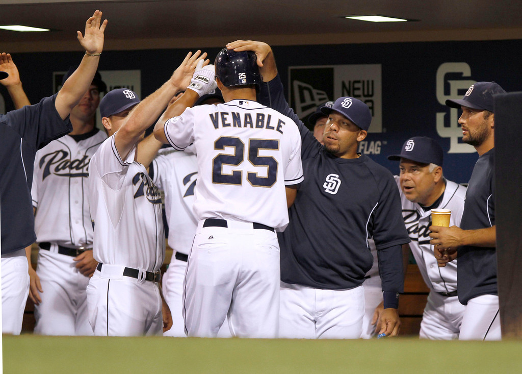 . San Diego Padres\' Will Venable is congratulated by teammates after his solo home run during the first inning of their baseball game against the Colorado Rockies on Friday, Sept. 6, 2013, in San Diego. (AP Photo/Don Boomer)
