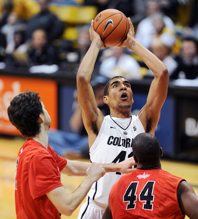 . Josh Scott of CU goes back up on Oren Faulk of Hartford, after an offensive rebound, during the second half of the December 29, 2012 game in Boulder. (Cliff Grassmick / Daily Camera) December 29, 2012