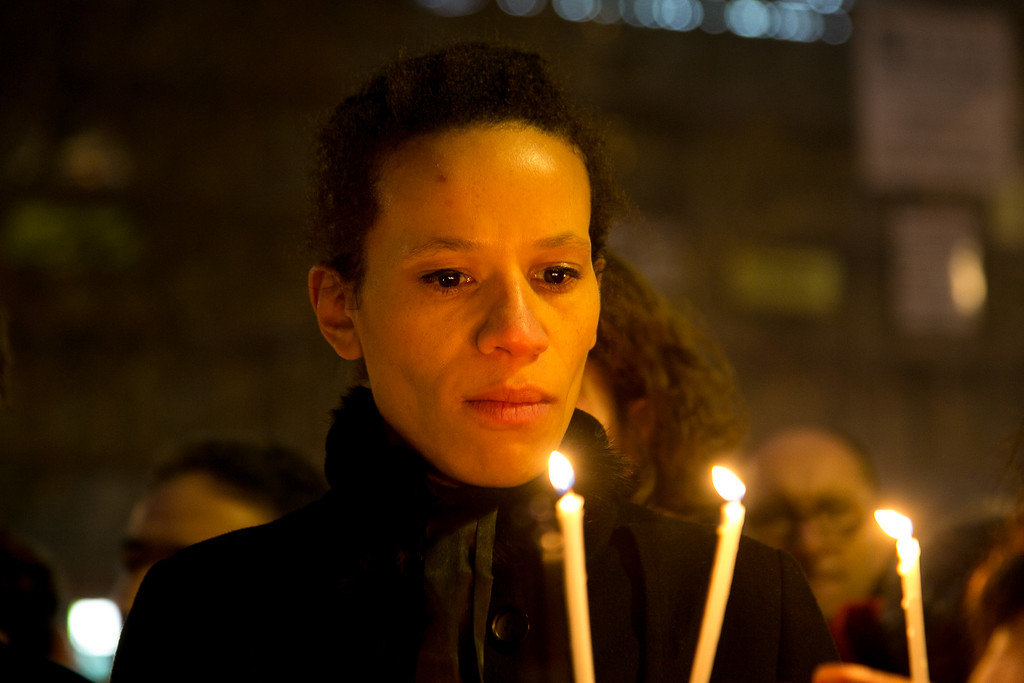 . People hold a candles as crowds gather at \'Place de la Republique\' for a vigil following the terrorist attack earlier today on January 7, 2015 in Paris, France. Twelve people were killed, including two police officers, as two gunmen opened fire at the offices of the French satirical publication Charlie Hebdo.  (Photo by Marc Piasecki/Getty Images)