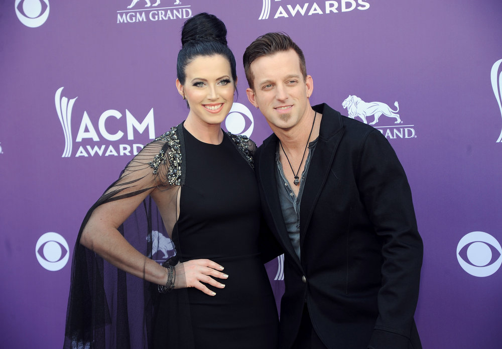 . Shawna Thompson, left, and Keifer Thompson, of musical group Thompson Square, arrive at the 48th Annual Academy of Country Music Awards at the MGM Grand Garden Arena in Las Vegas on Sunday, April 7, 2013. (Photo by Al Powers/Invision/AP)