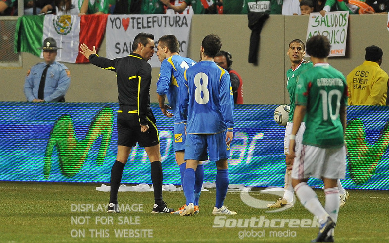 Bosnia-Herzegovina's Forward Vedad Ibisevic (#14) argues with Referee Jair Marrufo during Soccer action between Bosnia-Herzegovina and Mexico.  Mexico defeated Bosnia-Herzegovina 2-0 in the game at the Georgia Dome in Atlanta, GA.