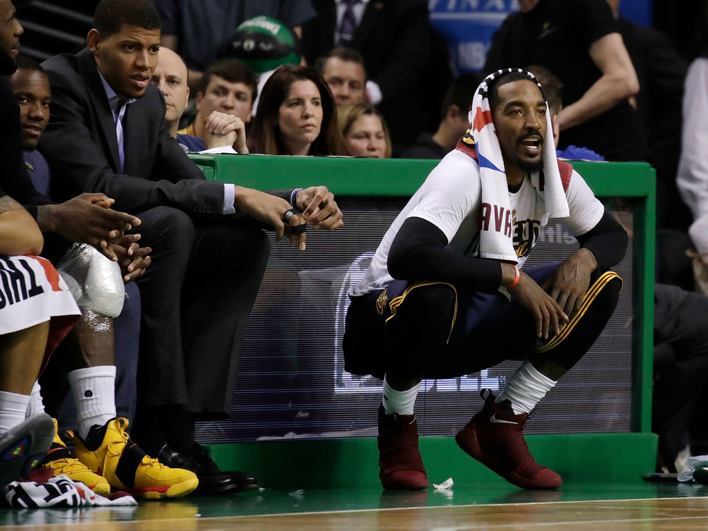 . Cleveland Cavaliers guard J.R. Smith, right, shouts encouragement from the sideline during the second half of Game 2 of the NBA basketball Eastern Conference finals against the Boston Celtics, Friday, May 19, 2017, in Boston. (AP Photo/Elise Amendola)