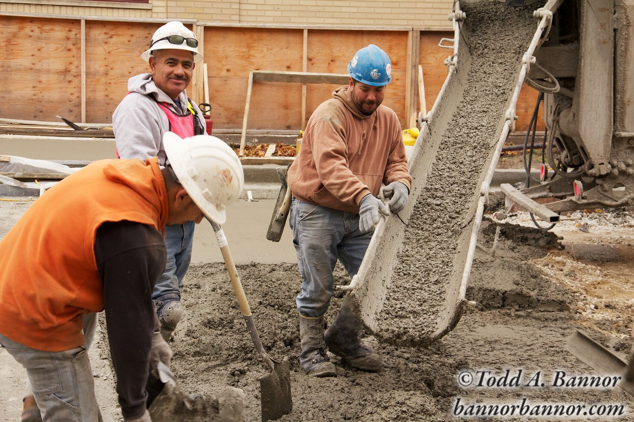 Construction workers pour concrete during Marion Street reconstruction project on Saturday November 19, 2011 in Oak Park, Illinois USA.