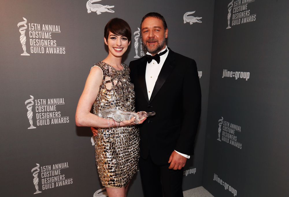 Description of . Actors Anne Hathaway (L) and Russell Crowe attend the 15th Annual Costume Designers Guild Awards with presenting sponsor Lacoste at The Beverly Hilton Hotel on February 19, 2013 in Beverly Hills, California.  (Photo by Christopher Polk/Getty Images for CDG)